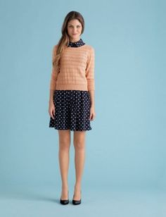 Wear it to work.A fit-and-flare polka-dot dress looks adorable on its own—and doubles as a great layering foundation.