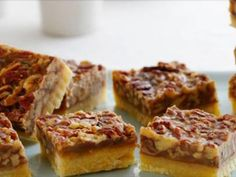 Get Pecan Squares Recipe from Food Network Pecan Recipes, Pie Recipes, Dessert Recipes, Desserts, Amish Sugar Cookies, Pecan Pie Bars, Holiday Recipes, Christmas Recipes, Dessert Bars