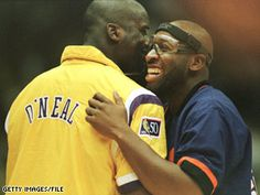 Wayman Tisdale greets Shaquille O'Neal during a game November 1, 1996.