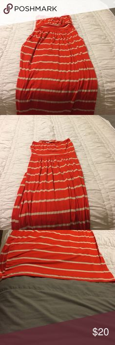 Red and cream striped maxi dress This is a red and cream striped maxi dress. It is strapless and has pockets. This dress is a small but has been hemmed to fit someone 5'2''with a small heel Dresses Maxi
