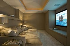 Cozy theater room. Perfect for finishing the basement! LOVE the cozy snuggle up couch idea :)