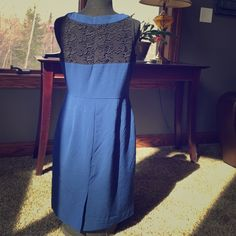 Beautiful blue detailed dress Gorgeous Lee detailed blue and black sheath dress! A clean silhouette from the front and gorgeous scrolling detail on the back! Never worn, no flaws, and from a smoke free home.  Happy shopping! Worthington Dresses Midi