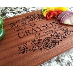 "Our Personalized Beautiful Large Mahogany Cutting Boards are absolutely stunning. Hand crafted from solid mahogany and beautifully laser engraved these cutting boards will be the show-piece of your kitchen. Our new ""Grayson"" design adds the perfect balance of class and beauty.  Customize with the couples' first names, last name, and anniversary.  This will look beautiful in your home whether on display or while in use!"