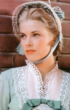 HIGH NOON (1952) - Gary Cooper (as 'Marshal Will Kane') - Grace Kelly (pictured - as the Marshal's young wife) - Directed by Fred Zinneman - United Artists - Publicity Still.