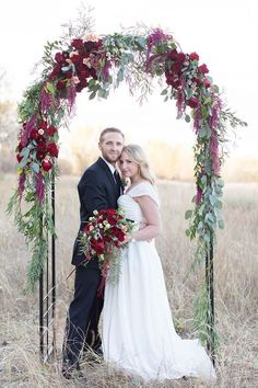 30 Winter Wedding Arches And Altars To Get Inspired: #18. Eucalyptus leaves and bold red flowers are ideal for a Christmas wedding