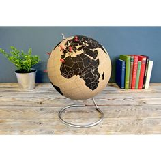 On Point Globe - Track your travels and plan your next adventure on this handsome cork globe. Color coordinate your jouney with a rainbow of pushpins for a unique look that's all you.