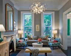 Eclectic Living Room : Light Fixture : Upholstery : Seating Arrangement :  Prominent Trim Around Windows
