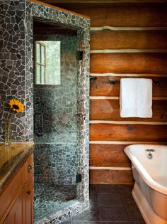 Old and new come together in the master bath, where traditional log chinking vies for attention with the eye-catching shower tiles.