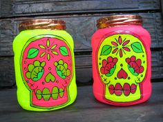 fabulously upcycled  two neon loud and funky sugar skull day of the dead, glass jar lanterns tea light holders. £32.00, via Etsy.