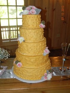 A golden cake by Kayla Knight Cakes!  Perfect for a formal evening wedding!