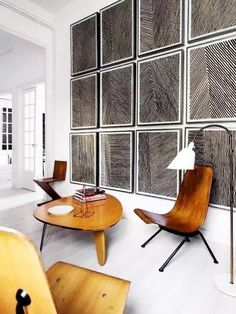 Living room with wood furniture and statement art