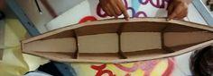 Canoa realizada en cartón para terminar en fibra y resina, parte de los objetos de escenografía para las escenas de Athabei.
