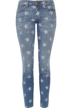 Buy or make a star rubber stamp. Dab the star in fabric paint then stamp it onto the pants