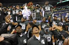 The MSU Spartans celebrate  after beating Ohio State 34-24 at the   Big Ten Championship football game Saturday 12/7/2013.   MSU will be heading to the Rose Bowl.