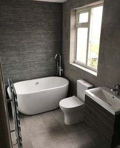 This contemporary bathroom uses grey to achieve a stylish yet understated effect.