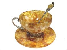 Gorgeous selection of beautiful Russian coffee cups made of natural amber and silver