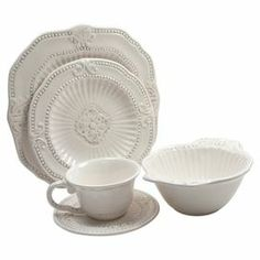 """20-piece earthenware dinnerware set with scrolling and raised dot details.     Product: 4 Dinner plates4 Salad plates4 Soup bowls4 Mugs4 SaucersConstruction Material: Earthenware Color: Antique whiteFeatures:  20 Ounce bowl capacity each8 Ounce mug capacity eachDimensions: Dinner plate: 10.75"""" Diameter eachSalad plate: 7.75"""" Diameter eachSoup Bowl: 3.45"""" H x 5.8"""" Diameter eachMug: 4.25"""" H eachSaucer: 5"""" Diameter eachCleaning and Care: Dishwasher safe"""