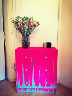 Upholstered an old chest of drawers with neon pink spray paint and farrow and ball duck egg paint - voila!