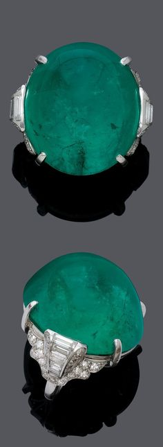 ATTRIBUTED TO MAUBOUSSIN - AN ART DECO PLATINUM, EMERALD AND DIAMOND RING, CIRCA 1930. Set with a fine Colombian emerald cabochon weighing 57.21 carats, with minor enhancement, the ring shoulders set with baguette- and single-cut diamonds. #Mauboussin #ArtDeco