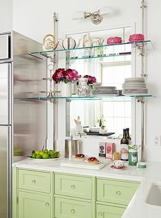 in the kitchen: glass shelves across a large mirror