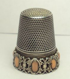 Beautiful Sterling Silver Thimble With Arch Designed Band AND Seven Coral Stones | eBay  Aug 25, 2013 / US $73.60 / 2,429.12 RUB