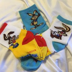 """3 pr Nesquik bunny socks chocolate milk To cute 3 pair of new Nesquik  bunny socks women's size 9-11(shoe size 5-9) Blue, white, and yellow crew sized. Although new one sock out of each pair the """"N"""" is backwards. This is not noticeable and they really an awesome set. 2 sets available, one set does not have cardboard tag around them. Accessories Hosiery & Socks"""