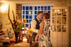 Bride and groom enjoy intimate dance under warm evening lights of Dorset restaurant photographed by one thousand words documentary wedding photographers Wedding First Dance, Wedding Day, Corfe Castle, Documentary, Photographers, Groom, White Dress, Restaurant, Lights