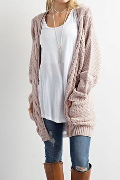 This Cable Knit Cardigan Sweater is so on trend this season! This cozy slightly oversized sweater is soft and features an open front with two front pockets. Throw this on over your favorite shirt and