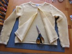 upcycling sweaters!  hmmmm, even boy sweaters can be upcycled into girl cardigans.  this tutorial looks really easy too!