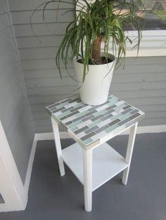 Depending on the size of your table, you might only need one sheet of leftover tile to totally transform the piece.  Get the tutorial at Pretty Handy Girl »   - http://HouseBeautiful.com