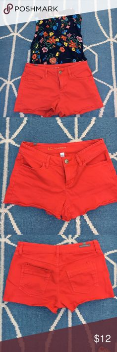 Lauren Conrad red frayed edge shorts size 2 Lauren Conrad red frayed edge shirts size 2. Color is bright red with a bit of wear at seams. Stretchy fit. Could fit size 0-2. Waist 14.5 in, waist to crotch 8 in, inseam 2.5 in (measurements are approximate and taken with shorts laying flat). 98% cotton, 2% spandex. Machine wash. Top not included. LC Lauren Conrad Shorts