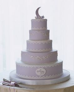 """See the """"Cake"""" in our  gallery--A sparkling moon-and-stars topper created with gum paste and luster dust adorns the cake, created by baker Ron Ben-Israel. Its tiers are covered in lavender fondant and decorated with gum-paste details."""