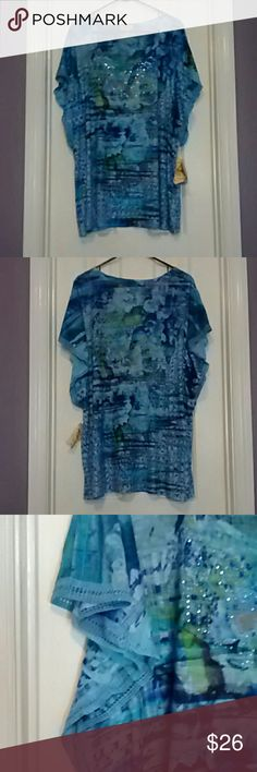 Size 2X Colorful Blouse Gorgeous One World Blouse with Blue Green and Aqua design and Silver and Blue bling on the neck and chest. Crochet design around the sleeves. 100% polyester. ONE WORLD Tops Blouses