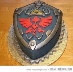 Awesome Legend of Zelda Hylian Shield Cake… Yes I do believe I want this to be my birthday cake.