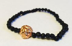 This is a very cool bracelet that is handmade in the USA.  The Tibetan style head is a shiny rose gold color made of alloy. The beads are natural lava gemstones (black). This bracelet will stretch to fit. May this bracelet bring you peace and healing within as well as strength and courage. A portion of each bracelet sold will go to the St. Jude Childrens Research Hospital. This bracelet is made by jj stevens, a family owned and operated fashion line. Made in the USA.  We have a 100%…