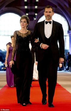 Spanish Crown Prince Felipe, right, and his wife Princess Letizia arrive at a gala dinner at the Rijksmuseum in Amsterdam