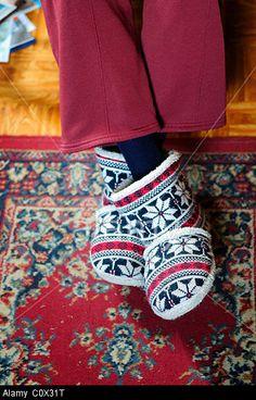 Elderly lady wearing slippers. © Ian Francis / Alamy