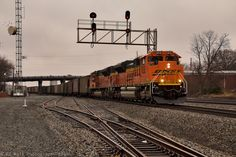 https://flic.kr/p/S3XqeL   NS 736 at Dalton, GA   After thundering over the CSX controlled interlock, NS 736 (Memphis,TN/BNSF-Juliette,GA) under cold dreary skies passes through downtown Dalton, GA (MP 40.1-H Hair) on its way to the massive Georgia Power Nuclear Facility Plant Scherer to dump the 150+ cars load of low sulpher Powder River coal. The same train some 24 to 48 hours from now will make an appearance through Dalton, GA heading northbound empty. One of the most unique, but…