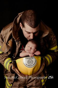 Newborn baby and fireman/firefighter daddy