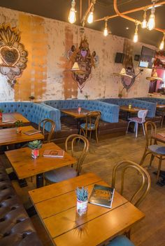 Mexican tequila bar and restaurant kitchen. Distressed and colourful. Booth seating and rustic timber plank table tops. Bentwood dining chairs.  Conduit pipe lighting feature