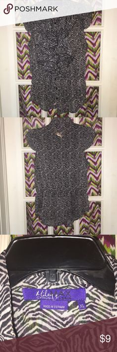 Miley Cyrus/Max Azria Sleeveless Blouse Miley Cyrus/Max Azria Sleeveless Blouse. Black and white ikat/zebra print. Slightly see thru but ruffle details give just enough coverage. VGUC Miley Cyrus & Max Azria Tops Blouses