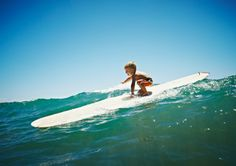 little one on a longboard