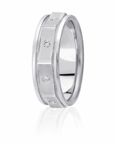 Concave Sections Are Flush Set With A Diamond In Each To Create A Truly Original Wedding Ring