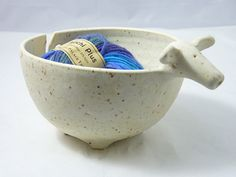 This listing is for a sheepish yarn bowl. You can pull your yarn through his mouth or through his, err, back area there. Hell make a thoughtful and quiet knitting companion.    Each piece is hand thrown on a potters wheel and glazed with lead free, food safe glazes. They are dishwasher and microwave safe because I would not sell you something I would not use myself.    Measures 8.5 from nose to tail and 4.25 tall. Bowl alone is approx. 6x65 and 3.5 tall.    Yarn not included.