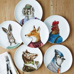 Plates decorated with real animal paintings that designer Rachel Kozlowski dressed and accessorized to give each animal its own personality.