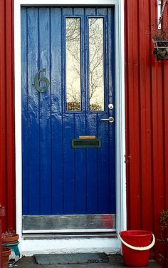 Blue door with red accent.