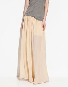 love the combination of the flowy peach maxi with the athletic gray tee