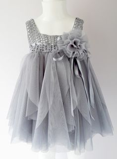 Lovingly hand-crafted tutu dress is a work of art in itself. Little miss will look adorable in this dress with jubilant skirt full of softest fluffy tulle and crochet bodice.  It is specially designed with a baby in mind . Special ruffle cut makes them look like tulle flower petals. It is made with premium quality materials and with great attention to details.  Stretchy and silky soft crocheted base of the skirt and band makes this set so comfortable for active little ones. It is very easy…