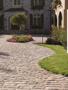 Create a stylish driveway with stone pavers from Merkley Supply. Cobbled Driveway, Cobblestone Driveway, Landscape Pavers, Landscape Design, Garden Design, Driveway Design, Driveway Ideas, Hillside Garden, Garden Floor