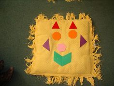 Teaching parts of the face and shapes in Spanish - Señor Cabeza Amarilla by lisibo, via Flickr